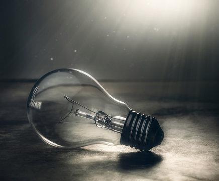 dark tone lightbulb lamp on the floor dramatic background concept.