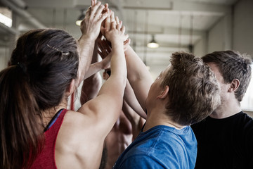 Fit People Giving High Five To Each Other In Gymnasium
