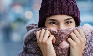 Woman feeling cold in winter