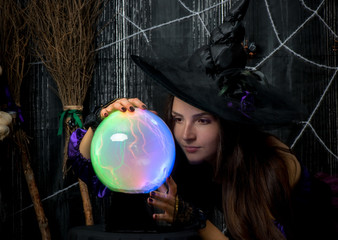 witch in a hat with a ball of fate in his hands