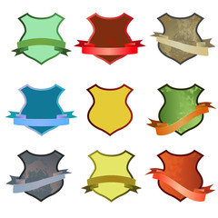 Set of vector colored shields with ribbons. Vector illustration isolated on white background
