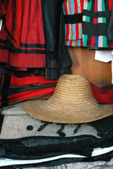 Traditional vintage clothes and a hat in a wardrobe