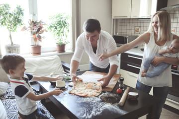 Keuken foto achterwand Koken Traditional family in kitchen, selective focus