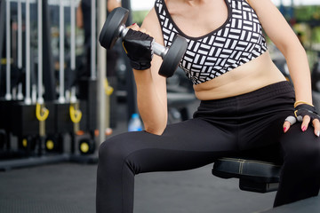 Fat woman workout in fitness gym for a fat burning.