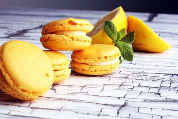 Foto auf Leinwand Macarons Sweet and colourful french macaroons or macaron with lemon