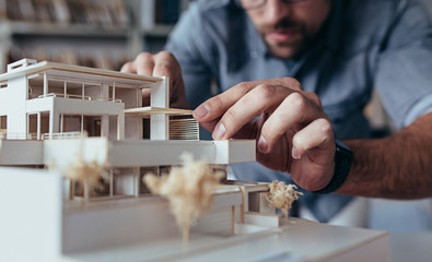 Architect hands making model house Wall mural