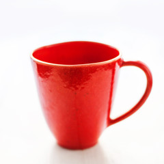 Red mug on a white background close up. Christmas red empty  cup for your design