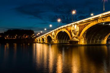 Illuminated bridge at dusk, Toulouse, France