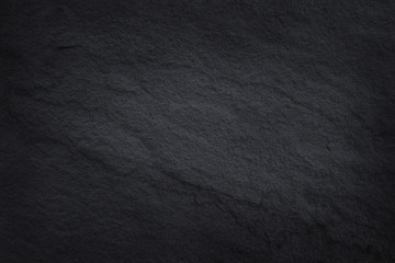 Dark brown slate texture in natural pattern with high resolution for background and design art work. Brown stone wall.