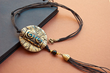 Boho tassel necklace. Trend Jewelry. Handmade jewelry from polymer clay.Mexican Jewelry. Ethnic pendant.Tribal Background.