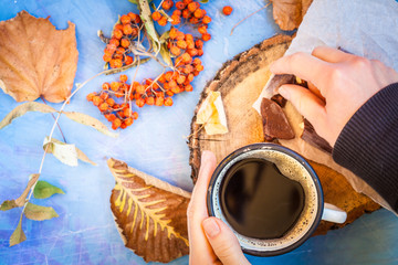 Autumn coffee with chocolate on a blue background