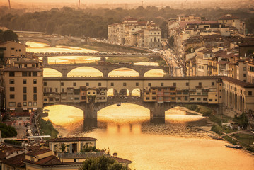 Wall Mural - Aerial view of Florence at sunset  with the Ponte Vecchio and the Arno river, Tuscany, Italy