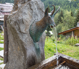 Chamois shaped mountain fountain in Val d'Aosta, Italy