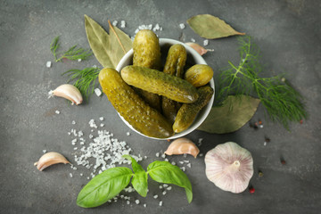Composition with pickled cucumbers on table
