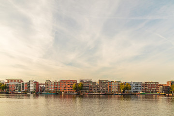 Contemporary apartment buildings and houseboats in Amsterdam