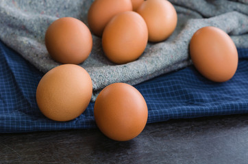 Close-up raw chicken eggs on fabric background