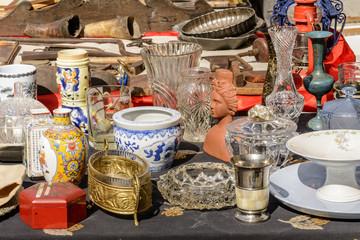 jumble of knick-knack and  trinkets on sale at street market, Chiavari, Italy