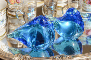 blue glass birds on sale at street market, Chiavari , Italy