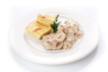 Delicious lunch. Casserole with mushroom sauce on white