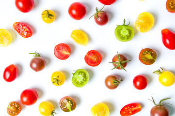 Red yellow and green cherry tomatoes background