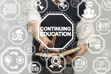 Continuing Education Business School concept. Man using virtual touch innovative interface with continuing education text button.