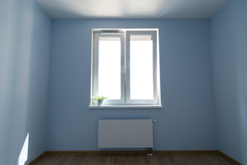 Empty room with painted walls, window and wooden floor