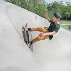 skateboarder man in action in skate park