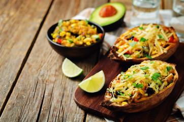 Black bean avocado corn stuffed sweet potatoes