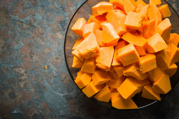 Pumpkin pieces in a glass plate free space