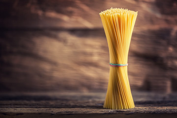 Spaghetti. Pasta spaghetti on rustic wooden background