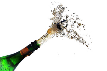 champagne bottle explosion with cork popping splash isolated against a white background, copy space, selected focus, motion blur