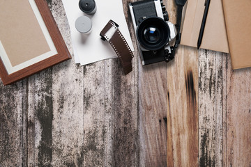 Camera and supplies, Blank photo frames on wood