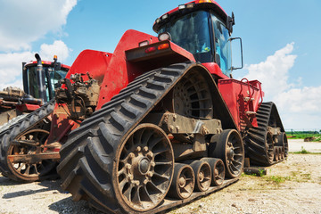 Harvesters and combine parts at the plant are waiting for sales, tractors and agricultural machinery, maintenance and exports