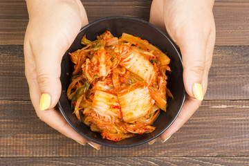 Kimchi or kimchee on black plate