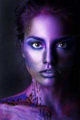 Beautiful woman with creative make-up.  Creative makeup, studio photo, photo processing. Blue