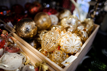 golden christmas ball in basket sold on market
