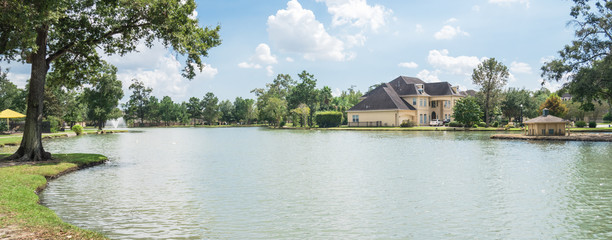 Residential houses by the lake in Houston, Texas, USA. Panorama style.