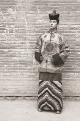 Young man in an old Mongolian costume.