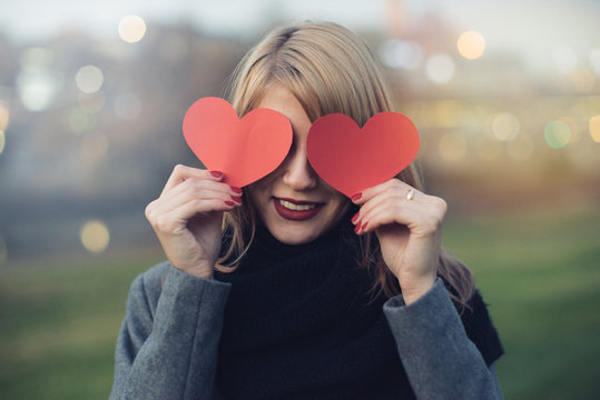 blonde woman playing with hearts