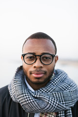 Portrait of an african american man wearing scarf on winter.