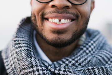 Closeup portrait of an african american man smiling on winter.
