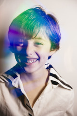 Double exposure of colorful reflection on boy's portrait