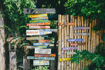 Many signposts with direction and distance