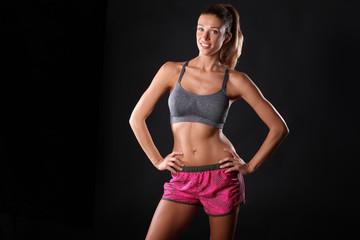 Healthy woman is working out. Fitness trainer.