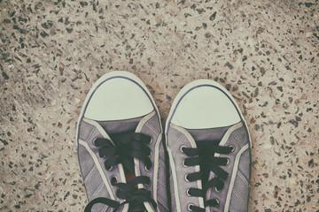 pair of old, worn sneakers