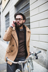 Young hipster talking on cell phone