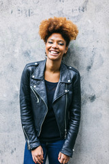 Young Afro Woman over a Light Concrete Wall