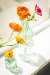 Flowers in vases on a windowsill