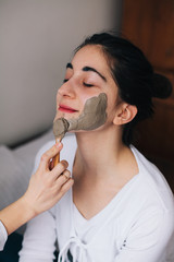 Woman with home made facial mask indoor