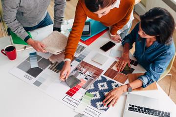 Group of creative interior designer architects discussing furnishings for new home